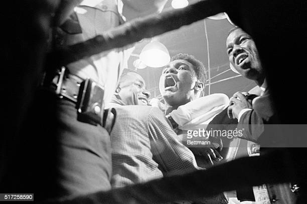 Happy Cassius Clay yells in joy inside the ring after he won a 7th round TKO victory and the world heavyweight championship over Sonny Liston.