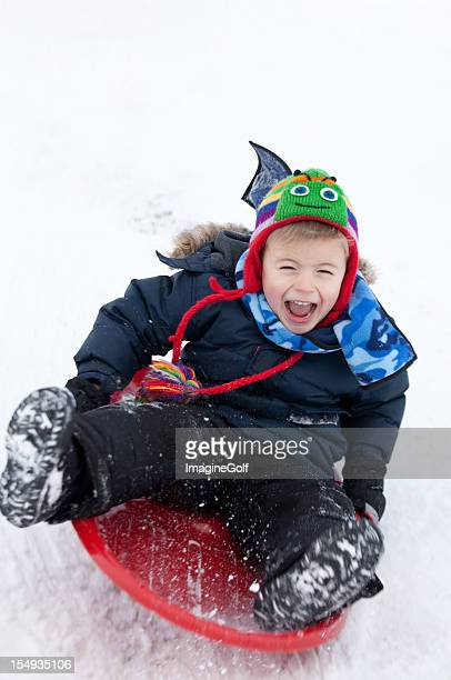 Happy Caucasian Boy Sliding in Winter