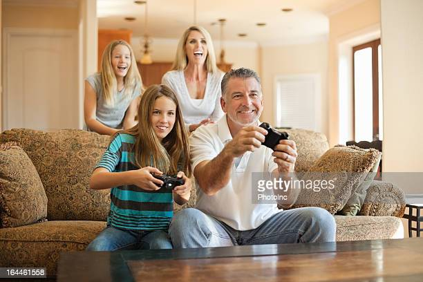 Happy Caucasian family having fun playing videogames