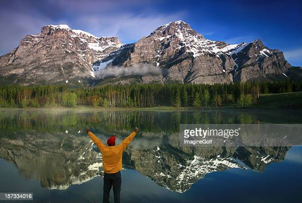 happy caucasian middle aged man in the mountains - kananaskis country stock pictures, royalty-free photos & images