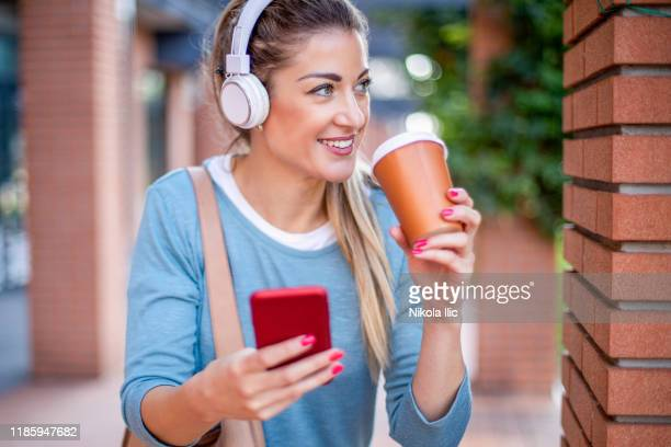 happy caucasian young woman with coffee. coffee and music. - radio stock pictures, royalty-free photos & images