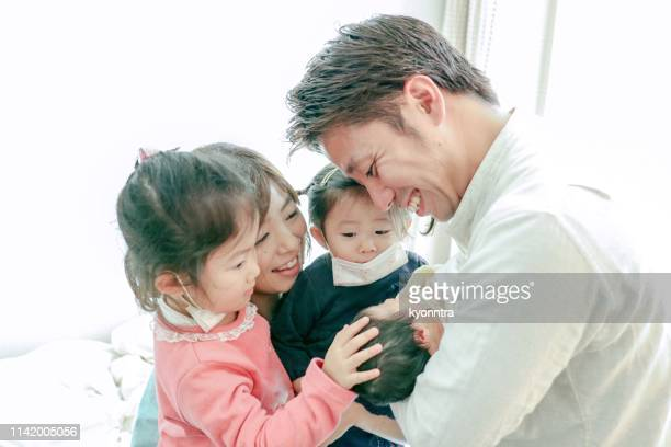 happy celebration for new family - japanese breastfeeding stock pictures, royalty-free photos & images