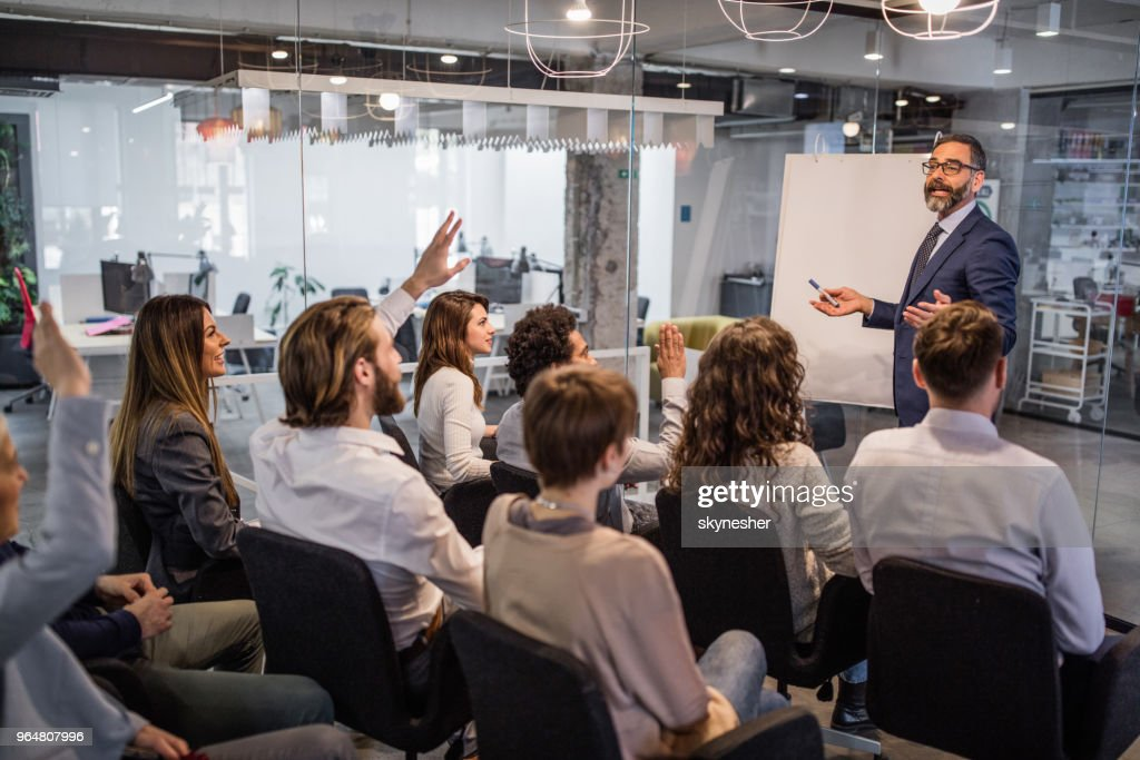 Happy CEO giving his team a business presentation in a board room. : Stock Photo