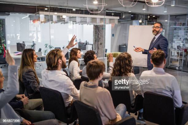 happy ceo giving his team a business presentation in a board room. - presentation stock pictures, royalty-free photos & images