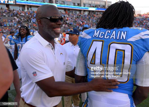 Happy Chargers head coach, Anthony Lynn congratulates Chris McCain after their win in Carson, CA on Sunday, October 22, 2017. The Chargers shut out...