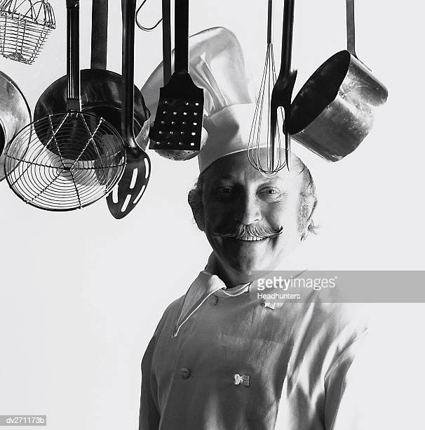 happy chef in kitchen - headhunters stock pictures, royalty-free photos & images