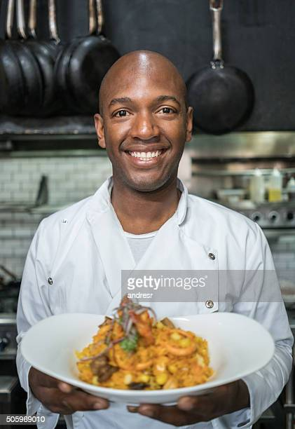 Happy chef presenting his plate