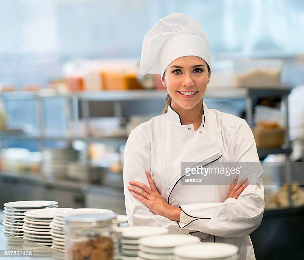 Happy chef working at a restaurant