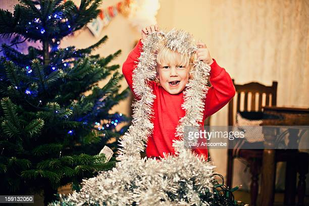 Happy child decorating the Christmas tree
