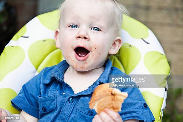 Happy child eating outdoors