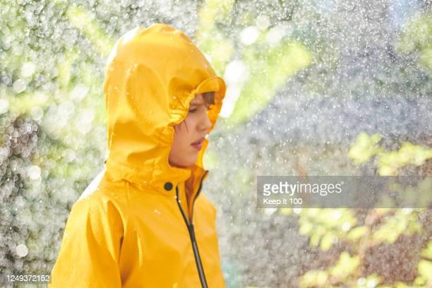 happy child enjoying the rain - rain stock pictures, royalty-free photos & images