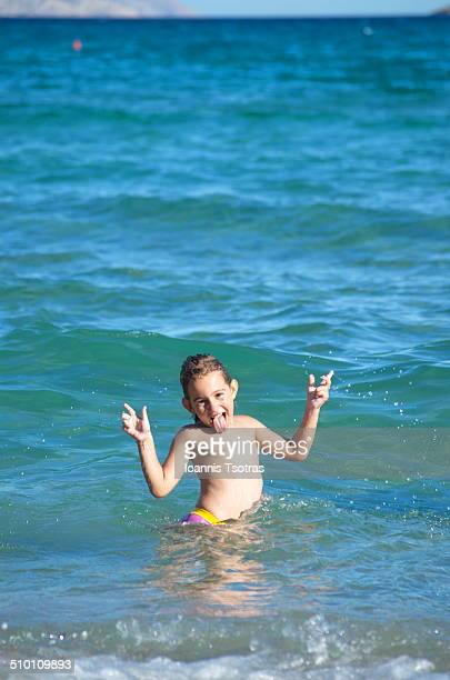 Happy child enjoying the sea