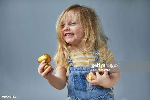 happy child holding easter eggs - easter stock pictures, royalty-free photos & images