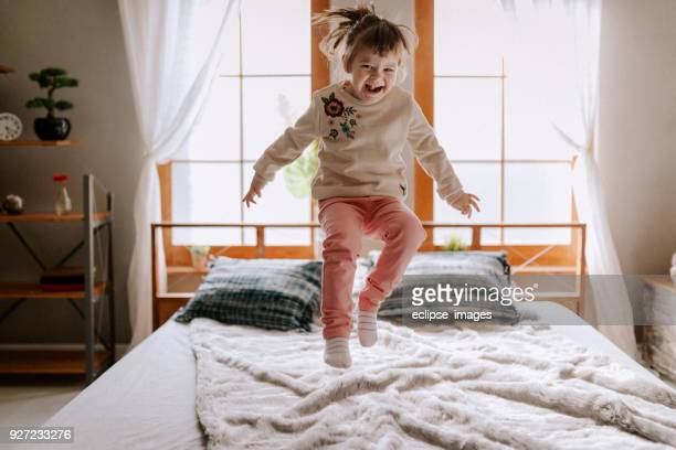happy child in bed - cartwheel stock pictures, royalty-free photos & images