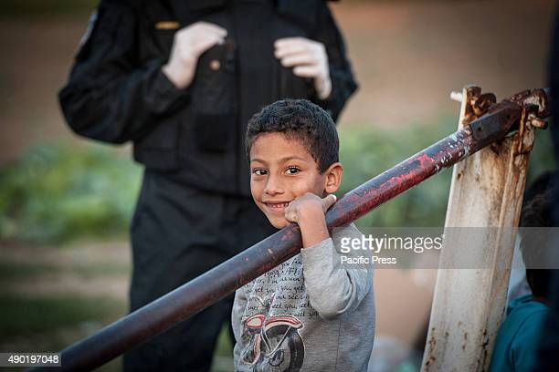BORDER BAPSKA SYRMIA CROATIA A happy child passing the SerbianCroatian border with the hope of finding a future in a safer place like Europe