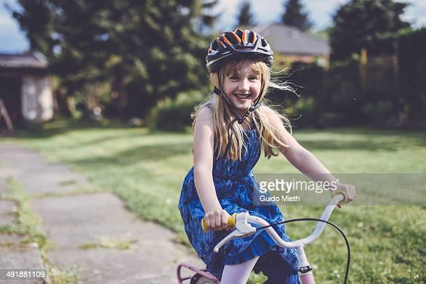 Happy child riding bike.