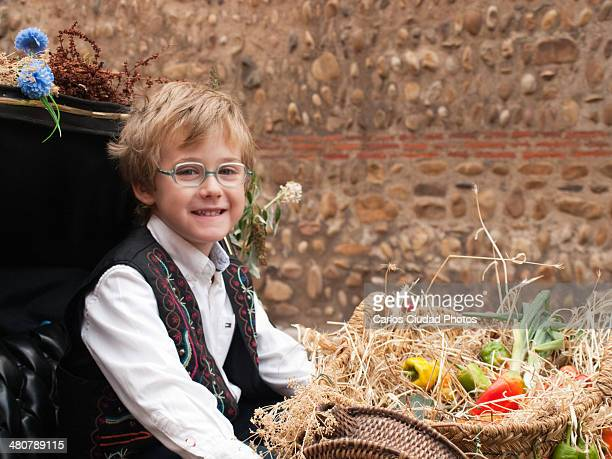 happy child sitting on a decorated cart - castilla leon fotografías e imágenes de stock