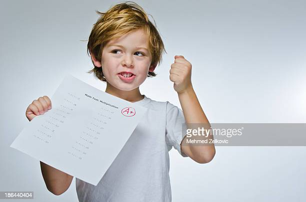 Happy child student with good grades