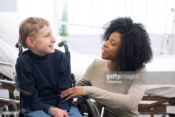 happy child with cerebral palsy - paraplegic stock photos and pictures