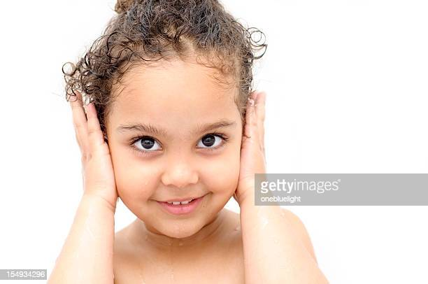 Happy Child ( 4-5) with Hands over Her Ears