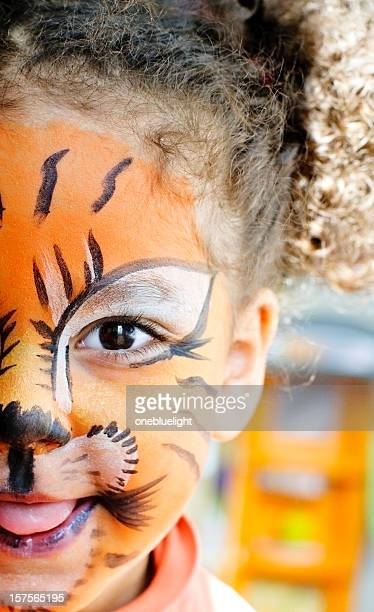 Happy Child with her tiger face paint.