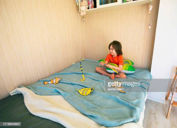 happy child with inflatable ring and drawing tropical fishes around him - epidemic stock pictures, royalty-free photos & images