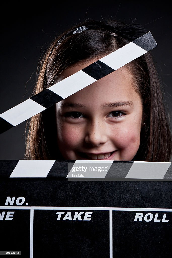 Happy child with movie clapper board. : Stock Photo