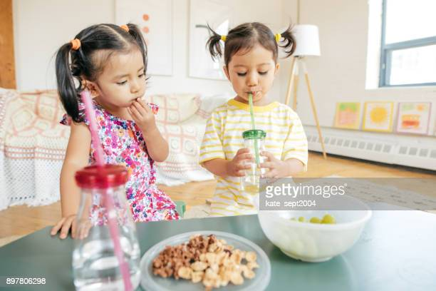 happy childhood - filipino family eating stock pictures, royalty-free photos & images