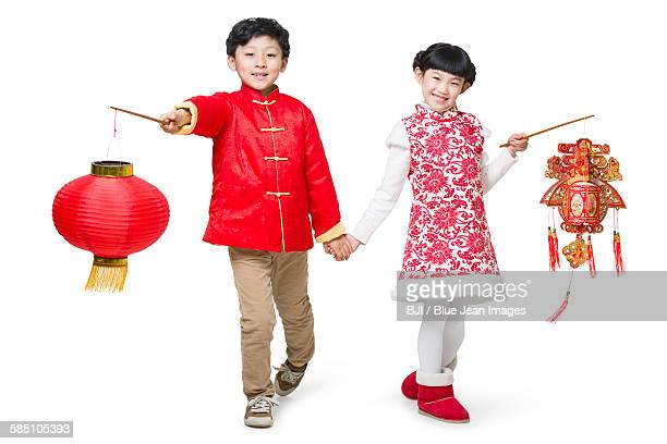 Happy children celebrating Chinese new year with traditional lanterns