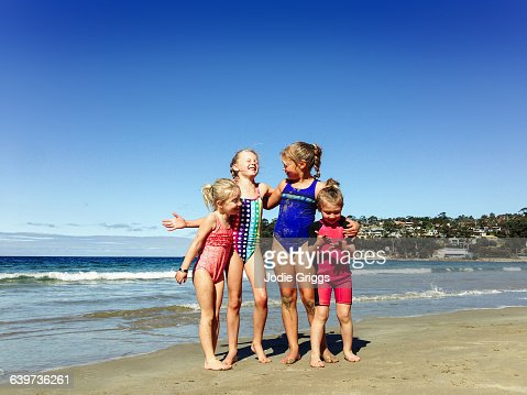 Happy children embracing at the beach