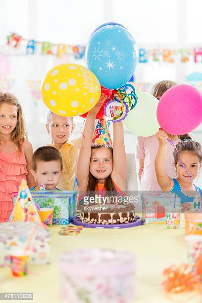Happy children enjoying at birthday party.