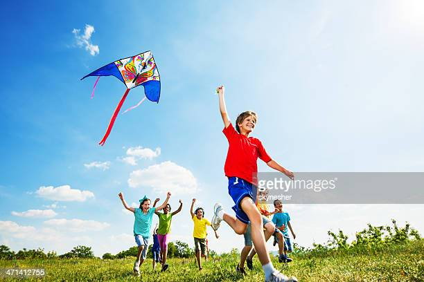 Happy children flying a kite.