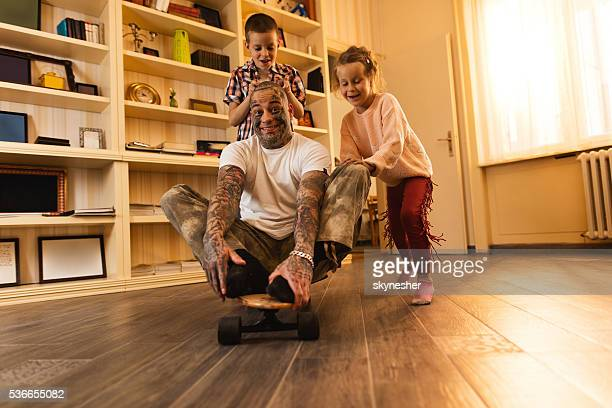 happy children having fun and playing with their father. - naughty daughter stock photos and pictures
