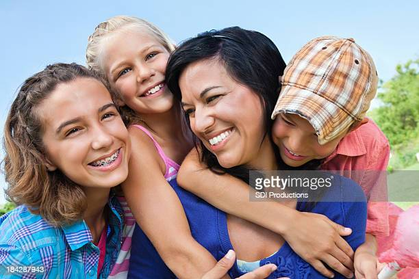 Happy Children Hugging Their Mother