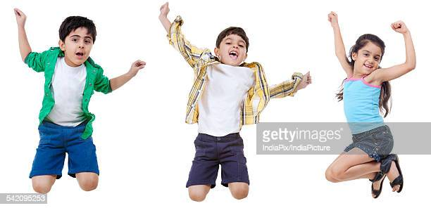 Happy children jumping over white background