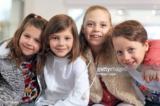 4 happy children - children only stock pictures, royalty-free photos & images
