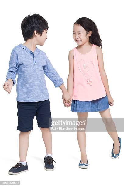 happy children - girls with short skirts - fotografias e filmes do acervo