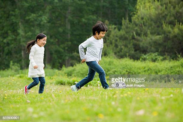 Happy children playing football together