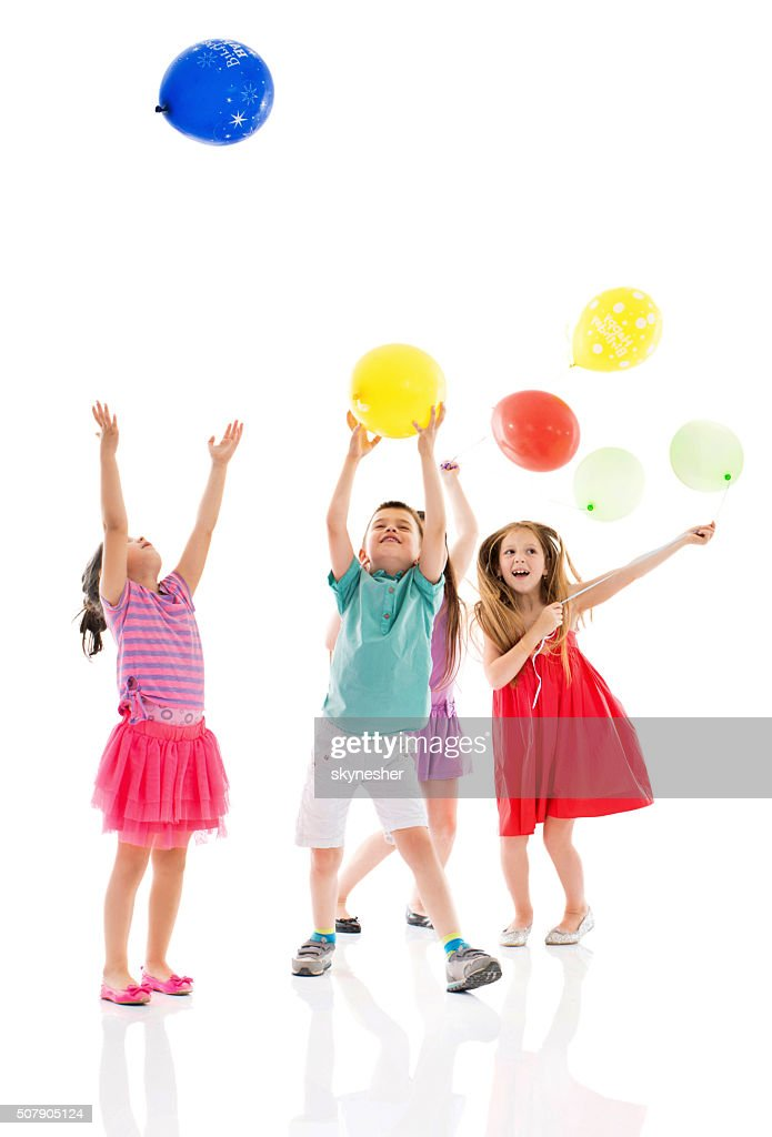 Happy children playing with balloons together. : Stock Photo