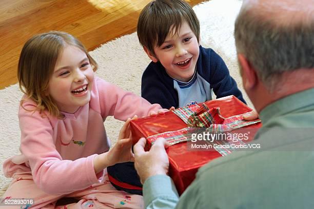 Happy children receiving a gift