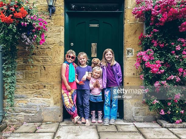 Happy children standing together in doorway