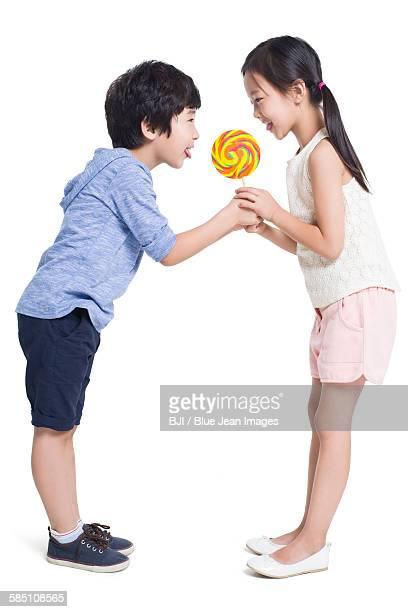 Happy children with lollipop