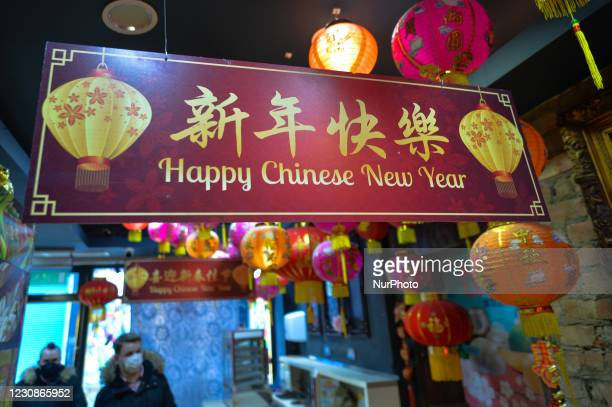 Happy Chinese New Year sign seen at the entrance to Asia Market in Dublin, the largest Asian food products supplier in Ireland. On Friday, 29 January...