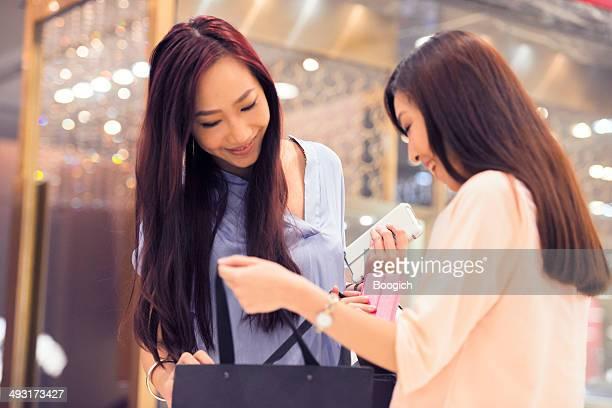 Happy Chinese Women Friendship Fun in Hong Kong Shopping Mall