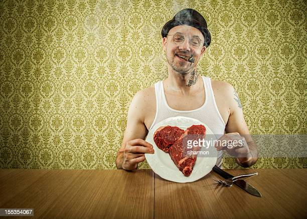 happy cigar smoking man showing off his valentines dinner - valentines day dinner stock pictures, royalty-free photos & images