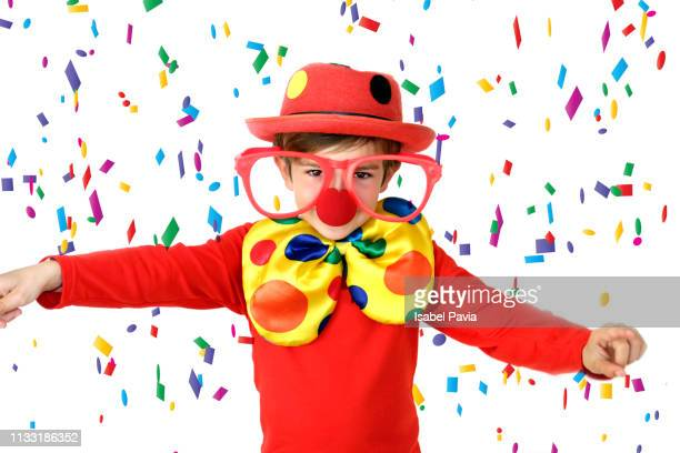 happy clown with confetti falling over him - happy clown faces stock photos and pictures