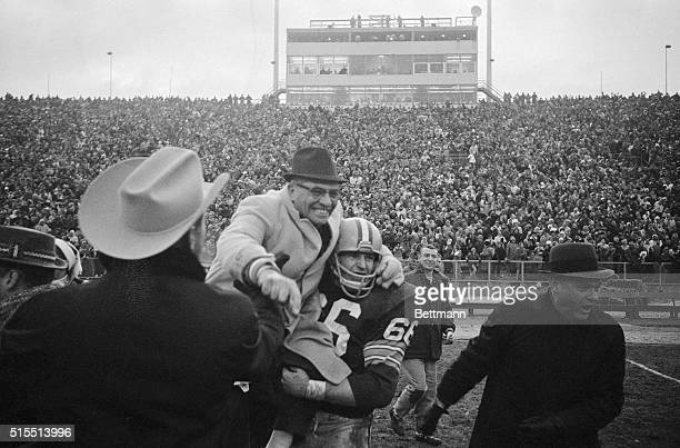 Happy coach is Packerson Vince Lombardi as he is carried off field by Ray Nitschke after team beat Baltimore Colts 13-10 in sudden death period of...