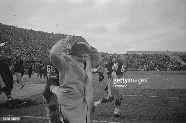A happy coach is Packerson Vince Lombardi as he is carried off field by Ray Nitschke after team beat Baltimore Colts 1310 in sudden death period of...