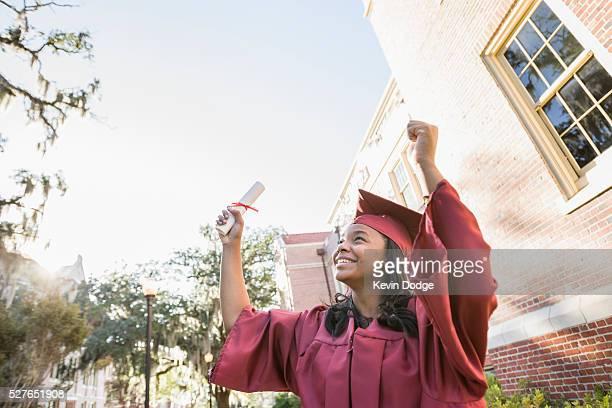 Happy college graduate celebrating