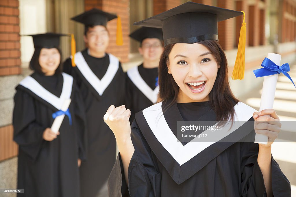 happy college graduate holding diploma  and make a fist : Stockfoto
